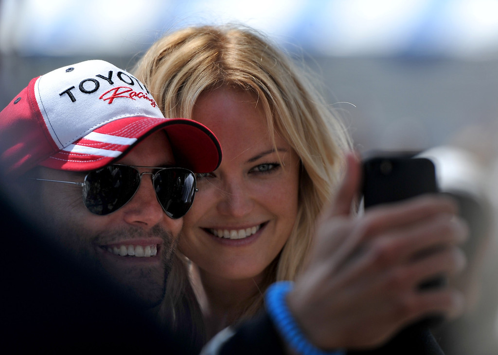 . Malin Akerman and Colin Egglesfield snap a selfie at the Toyota Grand Prix of Long Beach Pro/Celeb Race. Long Beach April 12, 2014. (Photo by Brittany Murray / Daily Breeze)