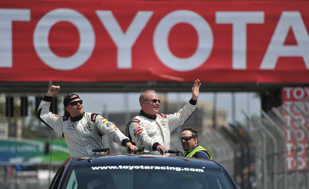 . Toyota Grand Prix of Long Beach Pro/Celeb Race winners Brett Davern and Al Unser Jr. on their victory lap after the race. Long Beach April 12, 2014. (Photo by Brittany Murray / Daily Breeze)