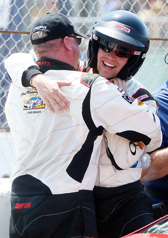 . Celebrity Brett Daven (right) and professional driver Al Unser Jr. (left) celebrate after winning their respective categories in the 38th annual Pro/Celebrity race at the 40th Toyota Grand Prix of Long Beach Saturday April 12, 2014.   (Will Lester/Inland Valley Daily Bulletin)
