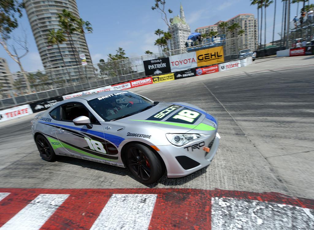 . Celebrity winner Brett Davern enters the hairpin Saturday. Celebrity Brett Daven and professional driver Al Unser Jr. won their respective categories in the 38th annual Pro/Celebrity race at the 40th Toyota Grand Prix of Long Beach Saturday April 12, 2014.   (Will Lester/Inland Valley Daily Bulletin)
