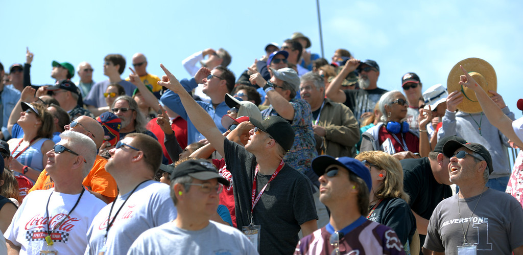 . Fans looks for a sky diver as the Pro Celebrity Race at the 40th Annual Toyota Grand Prix of Long Beach in Long Beach, CA. on Saturday April 12, 2014. (Photo by Sean Hiller/ Daily Breeze).