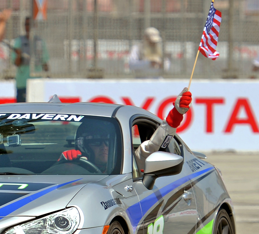 . Brett Davern takes a victory lap after winning the Pro Celebrity Race at the 40th Annual Toyota Grand Prix of Long Beach in Long Beach, CA. on Saturday April 12, 2014. (Photo by Sean Hiller/ Daily Breeze).
