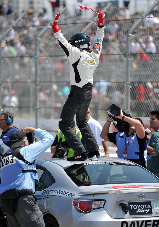 . Toyota Grand Prix of Long Beach Pro/Celeb Race winner Brett Davern jumps on top of his car after the race. Long Beach April 12, 2014. (Photo by Brittany Murray / Daily Breeze)