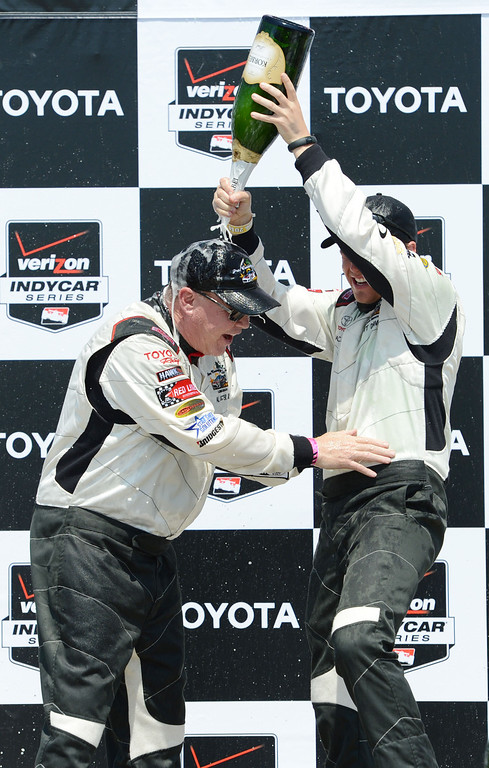 . Pro driver Al Unser Jr., left, and actor Brett Davern, right, and celebrate after the two won the Toyota Pro / Celebrity Race Saturday, at the 40th Annual Toyota Grand Prix of Long Beach.   	    Long Beach Calif., Saturday, April 12,  2014.   (Photo by Stephen Carr / Daily Breeze)