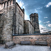 """Eastern State Penitentiary <br /> <br /> The prison is well known to have been the first for solitary confinement up until its overcrowding years later . The well known Al Capone had served time there . It is no longer in use as a prison and now open to the public for tours .<br /> <br /> This is an area where you will first enter into the """"Yard"""" , """"Inside""""  The image is a single image HDR since I was not using a tripod since I was on a tour . I did shoot with Bracketing but found my last images were blurry . I created 2 other exposures from light to dark and Processed it in photomatix .<br /> I am not sure whats going on with the sky but it is a true sky and I couldnt do anything in photoshop with it so I opted to leave it alone . <br />  I used Topaz de noise , Unsharpen Mask , Levels and curves adjustment and the equalize tool with fade ."""