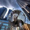 Part of my Photowalk for the day at Columbs Circle , You are looking at Trump Tower International to your right that includes the world sphere art. Then the Massive time Warner Building to your left . A densly populated area of Midtown Manhattan