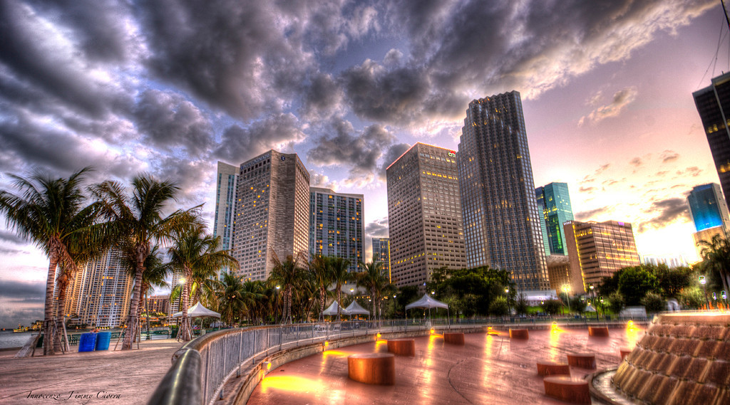 This is Bayfront Park , The location of 2010 Festival of speed in Miami . Millions of dollars worth of Exotics , Parked around this fountain . How could have I passed up an opportunity to take advantage of the South florida Skyline . <br /> <br /> This is a 5 image raw HDR without a tripod , So I had some help from the Chain link fence as pictured above . Enjoy