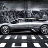 Photoshoot at Long Island City's Grafitti Park , Lamborghini Murcielago underneath the #7 train . The shadows on the street are the lights coming through the railroad ties . i desaturated it because the original color of pearl yellow was not friendly to HDr treatment .
