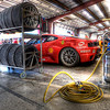 Ferrari Challenge day at NJMSP . The Ferrari 430 Challenge car garaged in between sessions .