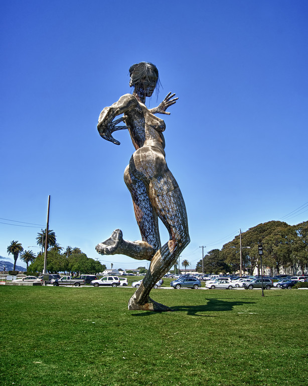 """Bliss Dance"", a sculpture created by artist Marco Cochrane. The 40-foot dancing woman towered over the Nevada desert at the 2011 Burning Man festival and now resides on Treasure Island, San Francisco.