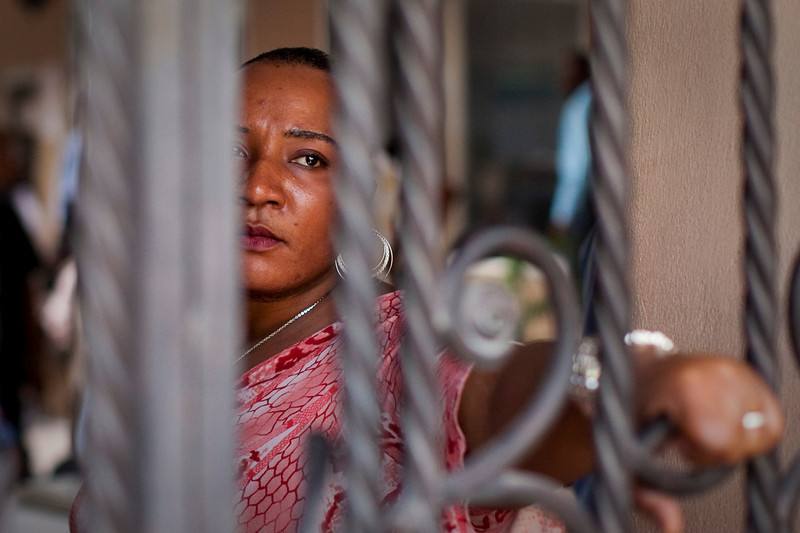 A woman waits for announcements to be made by the KEP, the Haitian Ministry of Elections, in Port au Prince, Haiti. Important announcements would often be kept secret until the last moment possible due to the high risk of inciting riots.