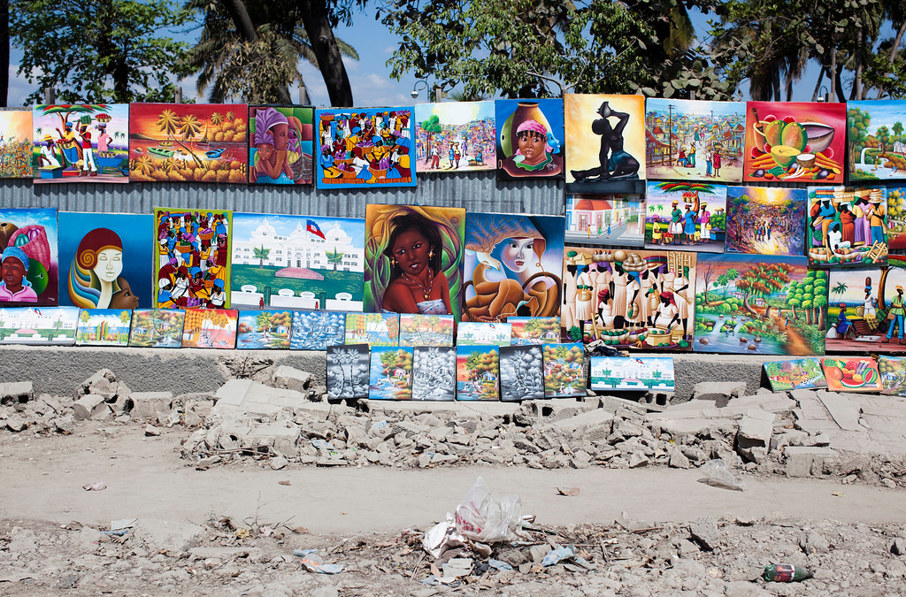 Art is sold along the torn up and dusty streets of downtown Port au Prince, Haiti.