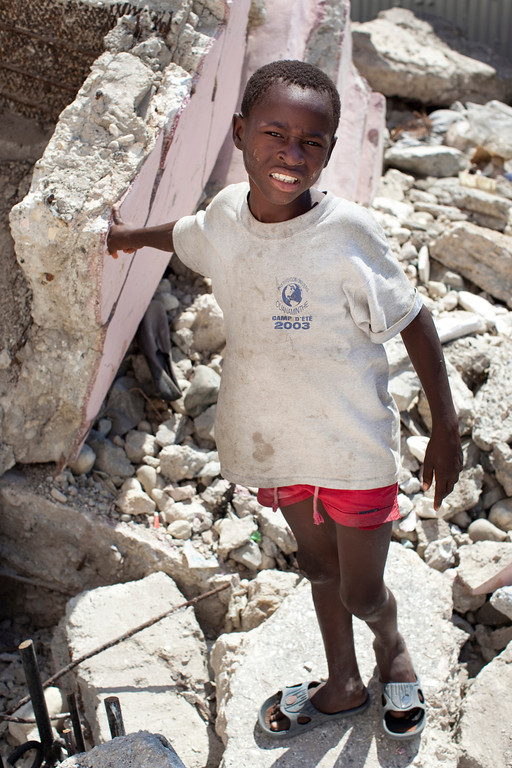 A young boy stands in the rubble of the Cathedral of Our Lady of the Assumption, in downtown Port au Prince, Haiti. No rubble has been removed and no reconstruction is underway on the almost century-old cathedral that fell during the December 2009 earthquake.