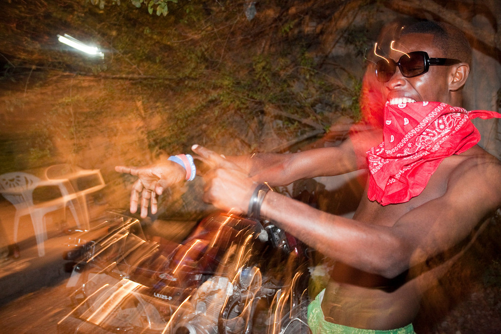 A Haitian man dances to local rap music at a party in the Delmas region of Port au Prince, Haiti. The earthquake left many Haitian musical artists with the responsibilty of both entertaining and being a voice for the Haitian people.