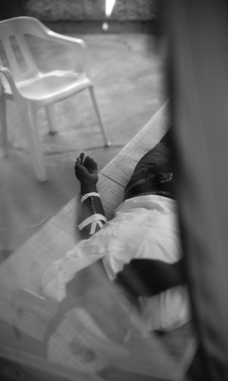 A cholera patient is given saline solution intravenously at the Kay Nou health center in downtown Port au Prince, Haiti. Cholera dehydrates its victim through diarrhea and vomitting, resulting in death unless treated.