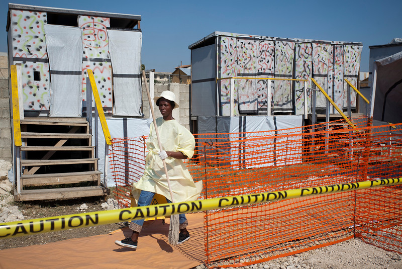 A woman cleans portions of the Zamni Lastante Cholera Treatment Center in the second largest refugee camp in Port au Prince, Haiti. Deaths related to cholera have risen above 4,000 in the past month.
