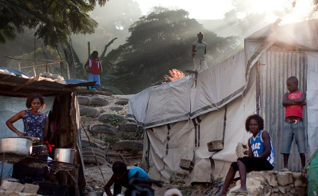 Residents in the hills above the Petionville region of Port au Prince, Haiti have set up housing structures out of sheet metal, tarps, and tires.
