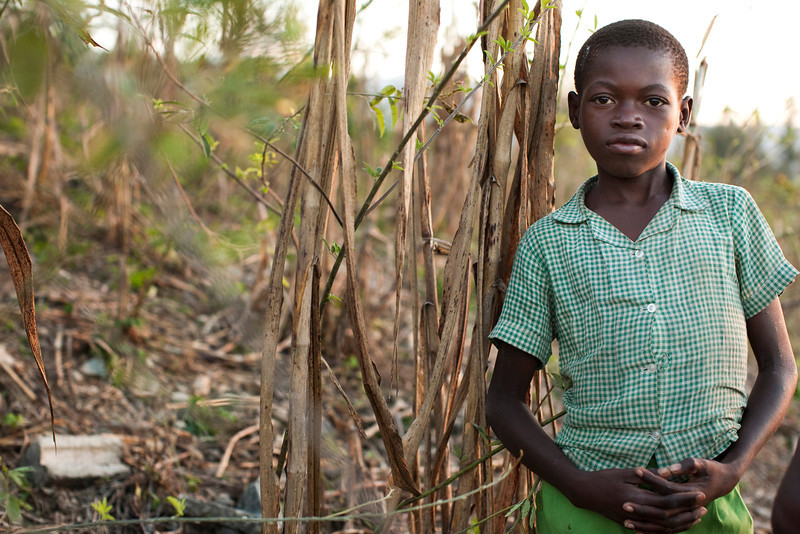 A young boy works the local farm land in the hills above Petionville, Port au Prince, Haiti.