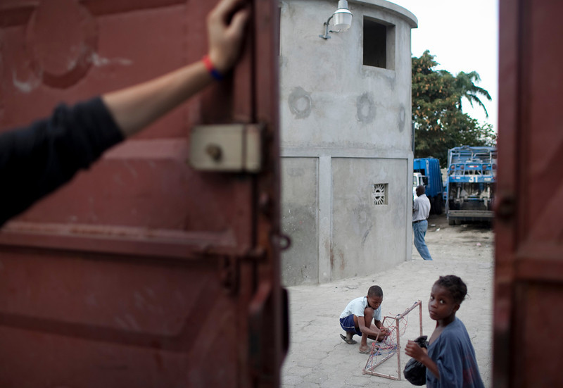 Children play in an ally way between the walls of various compounds in the Delmas region of Port au Prince, Haiti. Children that do not attend school often stick together and play in spaces off of the main streets to avoid trouble.