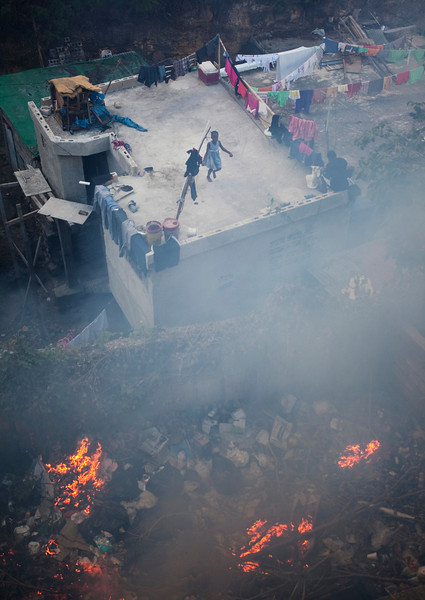 American NGO Lend a Hand and Foot has recently taken on the challenge of teaching Haitians EMT skills up to the level that a student in the US would be certified by. A little girl jumps rope above a trash fire located directly behind the organization's compound. Trenches are used all over Port au Prince to store trash, often set ablaze once full. Poor sanitation conditions in the region are the cause of many illnesses.