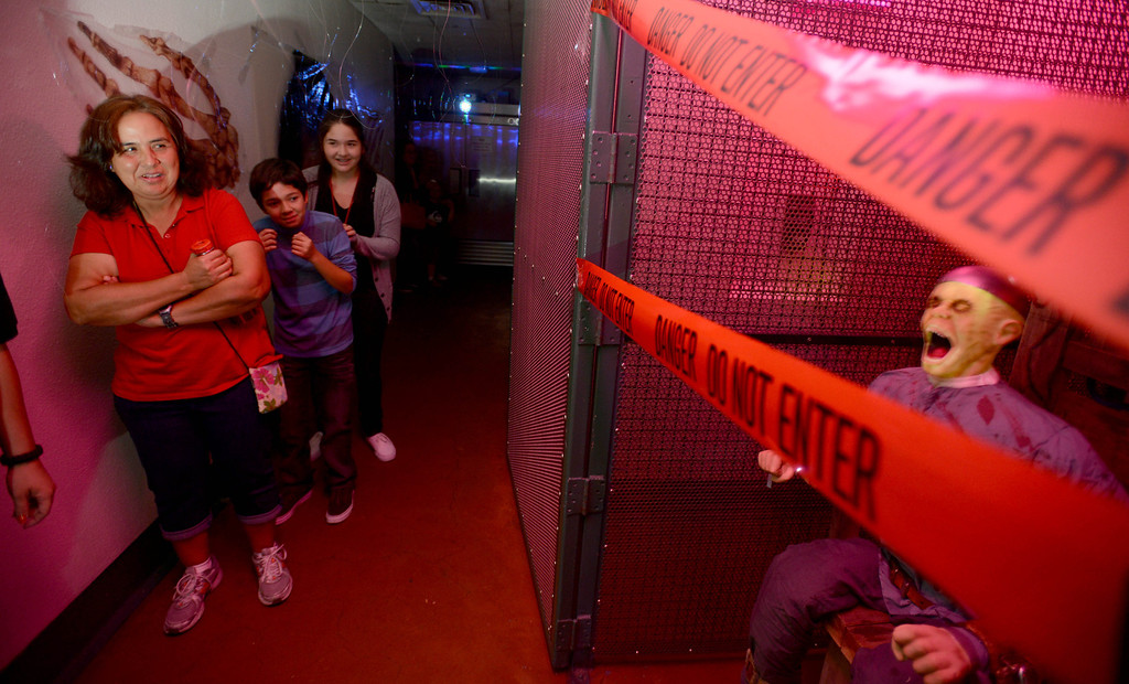 ". Griselda Padilla, left, Vanessa Hernandez,13, and Adrian Quezada,11, hold each other tight as they tour Lakewood Sheriffs Station\'s  ""Haunted Jail \"" in Lakewood, CA. on Friday, October 25, 2013. (Photo by Sean Hiller/Press Telegram)."