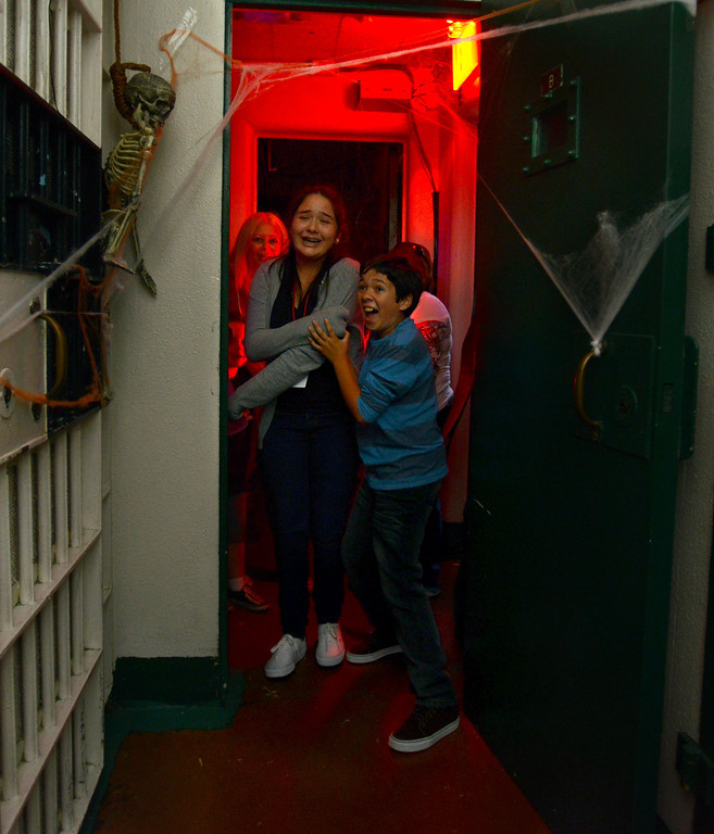 ". Vanessa Hernandez,13, and Adrian Quezada,11, hold each other tight as they tour Lakewood Sheriffs Station\'s  ""Haunted Jail \"" in Lakewood, CA. on Friday, October 25, 2013. (Photo by Sean Hiller/Press Telegram)."