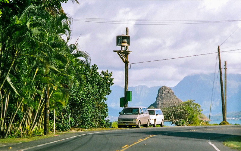 The Chinaman's Hat visible from roadway while driving Waikiki north shore.