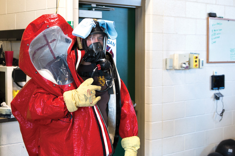 Matthew Gaston | The Sheridan Press<br>Fireman Jerry Johnston fixes a towel underneath the strap of his oxygen mask so he can wipe off steam and condinsation from the inside of his hazmat suit making it easier to see during training simulations Thursday, Oct. 18, 2018.
