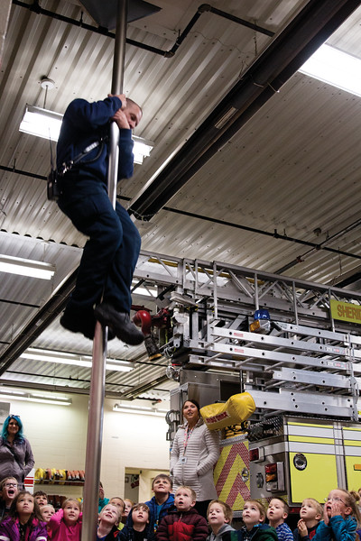 Matthew Gaston | The Sheridan Press<br>Kindergardners from Henry A. Coffeen Elementary are in awe of firefighter, Larry Grooms, as he slides down the fire pole at the Sheridan County Fire Station Tuesday, Oct. 9, 2018.