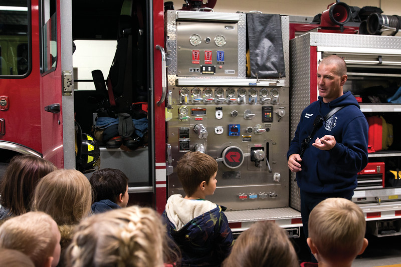 Matthew Gaston | The Sheridan Press<br>Firefighter/EMT, Larry Grooms, explains what each firefighter on the trucks job is and where they get to ride to kindergardners from Henry A. Coffeen Elementary Tuesday, Oct. 9, 2018.