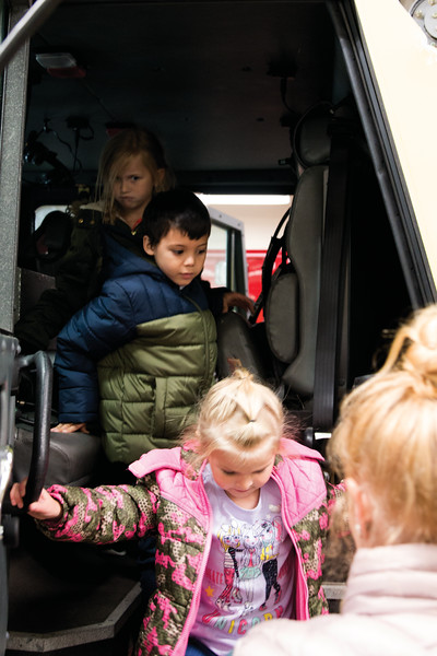 Matthew Gaston | The Sheridan Press<br>Kindergardners Ramzie Kirkpatrick, front, Ivyn Killion, center and Kinsleigh Lapp, back, from Henry A. Coffeen Elementary slowly climb out of the Ladder Truck at the Sheridan County Fire Station Tuesday, Oct. 9, 2018.