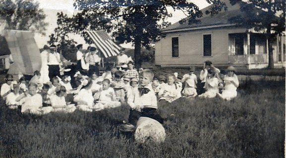 Ice Cream socia - note Swedish and US flags.  Young Gus Swanson in front/