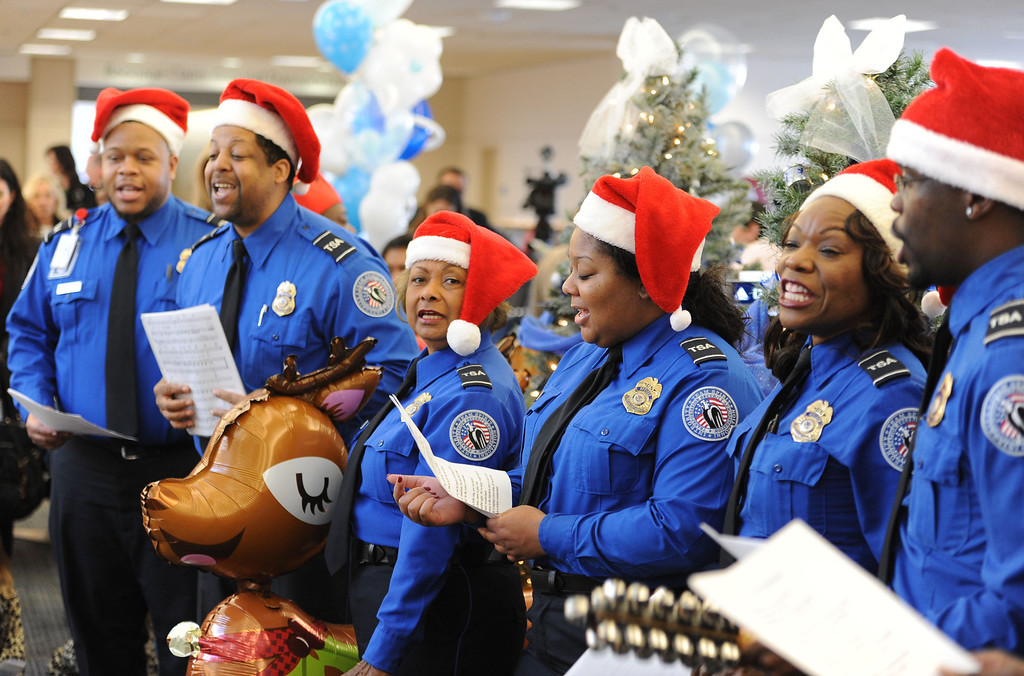. TSA choir sang holiday songs as the children sang along. Holiday in the Hangar at Delta Airlines at LAX. About 100 children from Children\'s Hospital, LA got to ride on a plane to the North Pole where holiday games and fun plus Santa awaited. (Dec 11, 2013. Photo by Brad Graverson/The Daily Breeze)