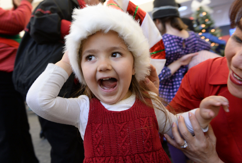 . Kayla Mendoza is all excited to see Santa at the Holiday in the Hangar  Delta Airlines event at LAX. About 100 children from Children\'s Hospital, LA got to ride on a plane to the North Pole where holiday games and fun plus Santa awaited. (Dec 11, 2013. Photo by Brad Graverson/The Daily Breeze)