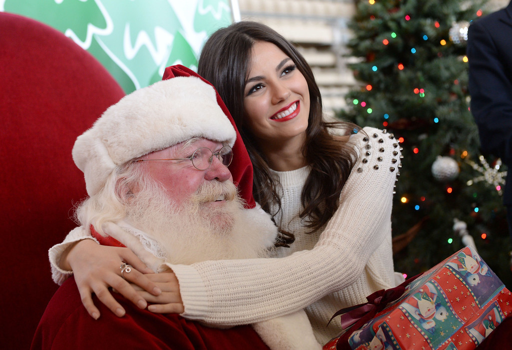 . Santa got a surprise as actress Victoria Justice sat in for a photo. Holiday in the Hangar at Delta Airlines at LAX. About 100 children from Children\'s Hospital, LA got to ride on a plane to the North Pole where holiday games and fun plus Santa awaited. (Dec 11, 2013. Photo by Brad Graverson/The Daily Breeze)