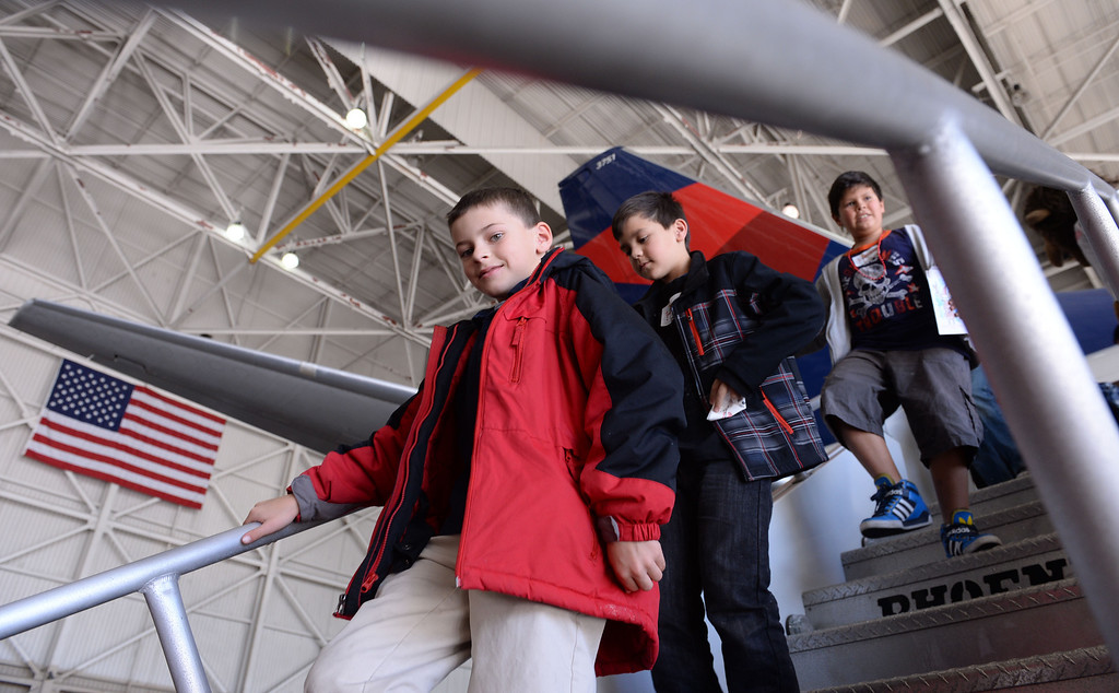""". Holiday in the Hangar at Delta Airlines at LAX. About 100 children Kids arriving at the \""""North Pole\"""". from Children\'s Hospital, LA got to ride on a plane to the North Pole where holiday games and fun plus Santa awaited. (Dec 11, 2013. Photo by Brad Graverson/The Daily Breeze)"""