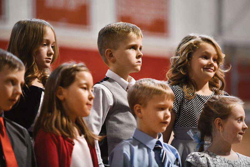 Matthew Gaston | The Sheridan Press<br>Back row from left, Bella Heizer, Calloway Vaughn and Helen Morris. Front row from left, Teegan Garcia, Aurora Kurnia-Creek, Gavin McClintock and Kenadie Larsen. 2nd graders from Holy Name Catholic School prepare to perform in the Christmas program Thursday, Dec. 20, 2018.
