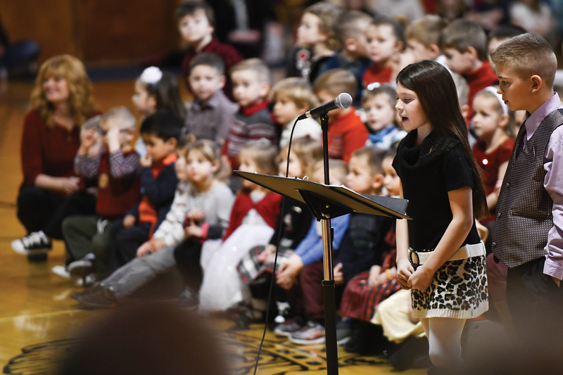 Matthew Gaston | The Sheridan Press<br>Sequoia Pack left and Connor Wood right, along with other Holy Name Catholic School 5th graders narrate a breif history about the origins of Czech Christmas traditions before the pre-K classes sing during the Christmas program Thursday, Dec. 20, 2018.