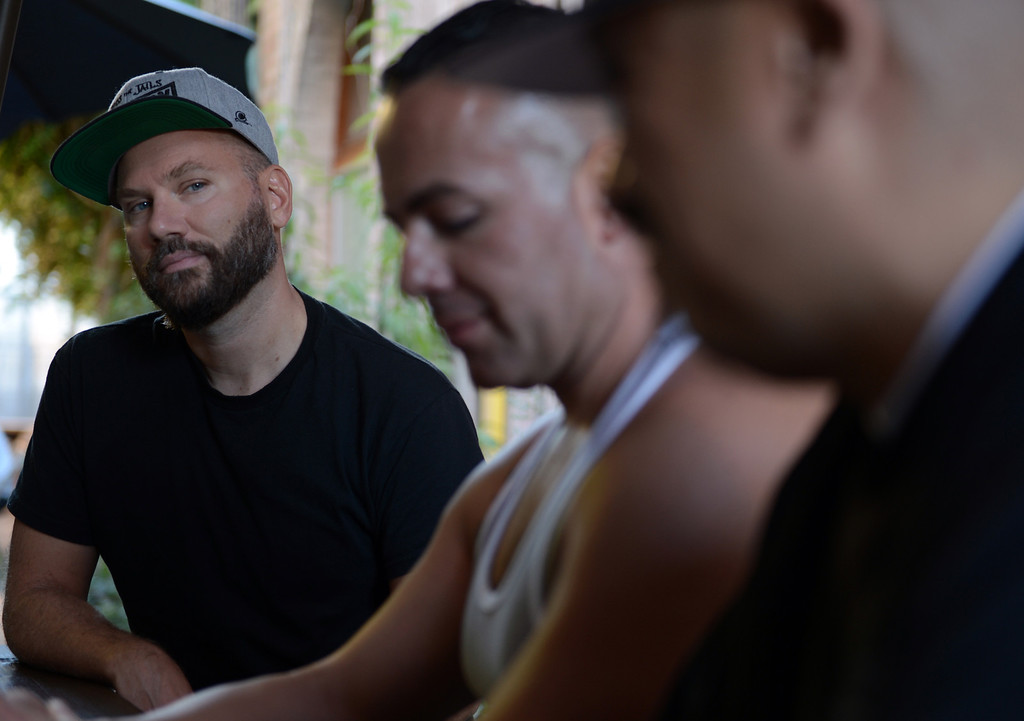 ". Dino Dinco, left, filmmaker looks at Sergio Romero, center, and Cisco Rios, right, who are in the documentary film ""Homeboy\"" which looks at gay gang members micro-culture within the gang culture in Los Angeles August 28, 2013. (Thomas R. Cordova/Staff Photographer)"