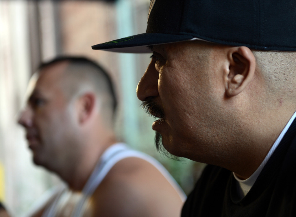 ". Cisco Rios, left and Sergio Romero, right, as the two talk about being gay gang members and about the documentary film ""Homeboy\"" which looks at gay gang members micro-culture within the gang culture in Los Angeles August 28, 2013.(Thomas R. Cordova/Staff Photographer)"