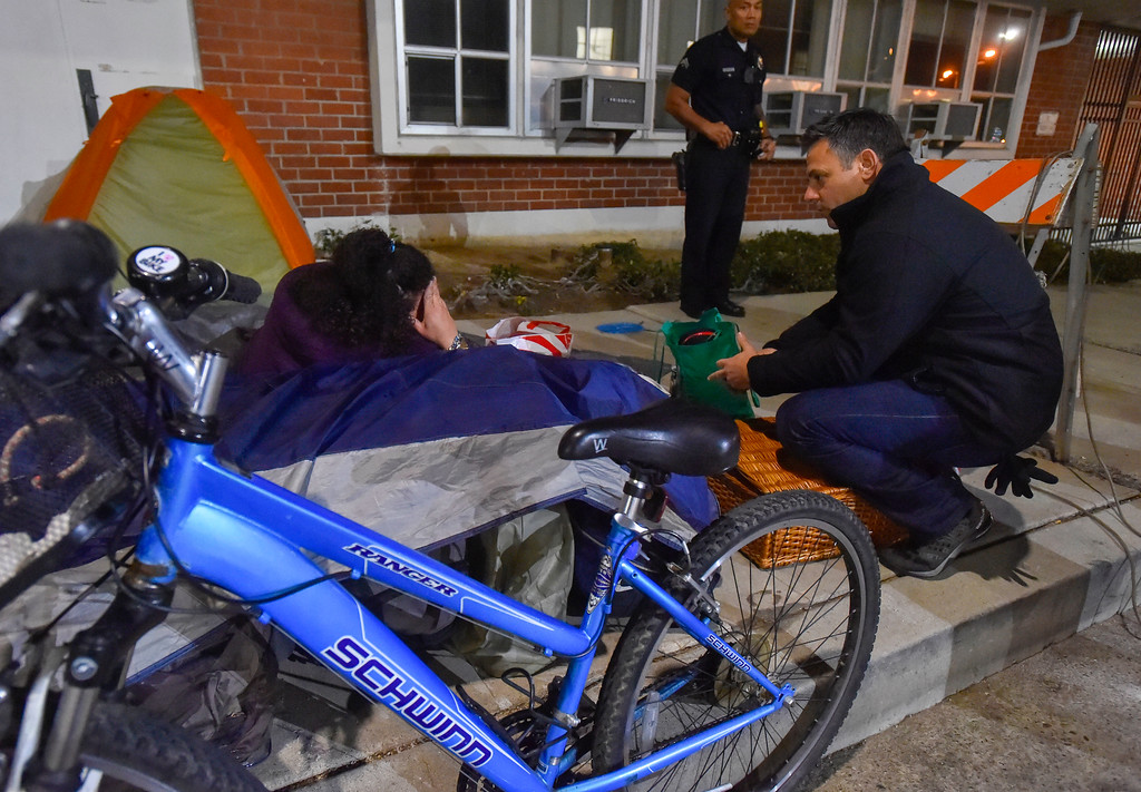 . Councilman Joe Buscaino talks with a homeless woman about her situation at her encampment along 8th Street in San Pedro, CA on Wednesday, January 25, 2017. Volunteers Wednesday fanned out across the city of Los Angeles to try to get an accurate homeless count in order to provide better services for the needy. (Photo by Scott Varley, Daily Breeze/SCNG)