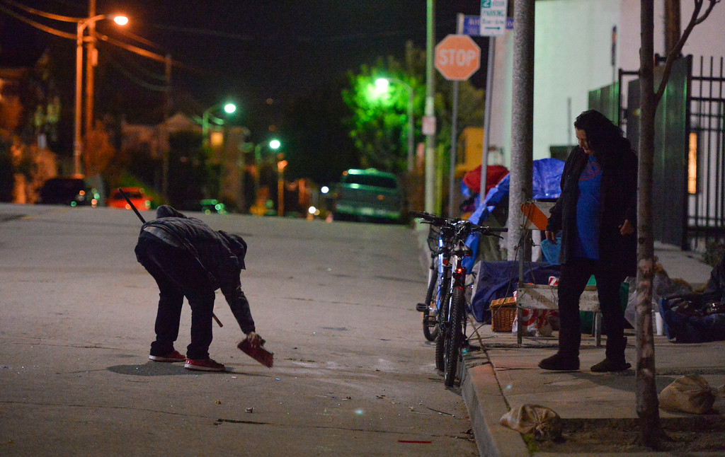 . A homeless man sweeps up trash next to his tent on an 8th Street sidewalk in San Pedro, CA on Wednesday, January 25, 2017. Volunteers Wednesday fanned out across the city of Los Angeles to try to get an accurate homeless count in order to provide better services for the needy. (Photo by Scott Varley, Daily Breeze/SCNG)
