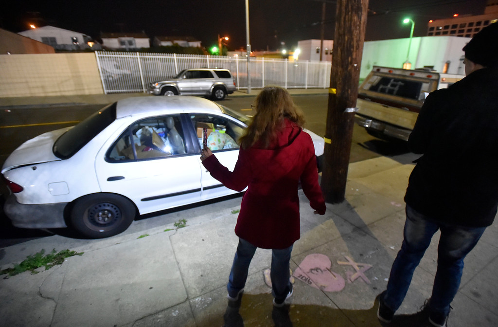 . While looking for homeless people to count, Cathy Hetzer, left, and Chris Jenne shine a light on a car full of posessions parked on Palos Verdes Street in San Pedro, CA on Wednesday, January 25, 2017. Volunteers Wednesday fanned out across the city of Los Angeles to try to get an accurate homeless count in order to provide better services for the needy. (Photo by Scott Varley, Daily Breeze/SCNG)