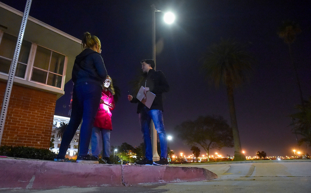 . Homeless census takers Cathy Hetzer, center, and Chris Jenne, right, talk to a homless woman along 8th Street in San Pedro, CA on Wednesday, January 25, 2017. Volunteers Wednesday fanned out across the city of Los Angeles to try to get an accurate homeless count in order to provide better services for the needy. (Photo by Scott Varley, Daily Breeze/SCNG)
