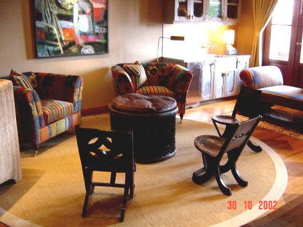 Interior design combining exquisite Italian fabrics with ethnic tribal furniture.