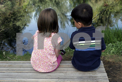 Boy and girl share a day fishing.