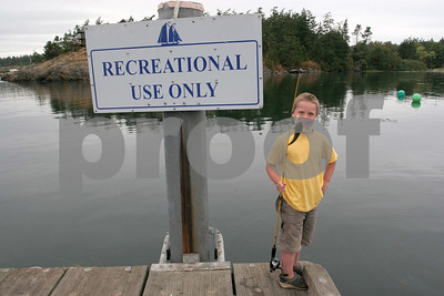 Boy fishing on dock.