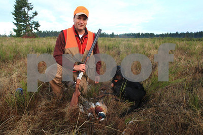 A proud pheasant hunter with his dog.