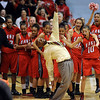 Denver East coach, Dwight Berry, slips on the ice , but keeps his balance, after being doused with water after East won the 5A  Colorado State Championship over Legacy on March 12, 2010 in Boulder.<br /> <br /> Cliff Grassmick / March 12, 2010