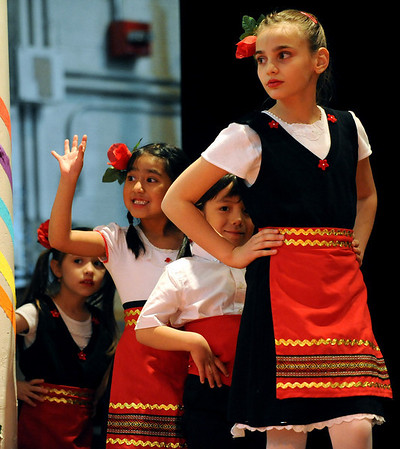 """Sarina Nikolova, right, leads a group of children out to perform Bulgarian dances.<br /> The University of Colorado hosted the 20th Annual International Festival on Saturday that featured traditions, customs and food  from around the world.<br /> For more photos and a video, go to  <a href=""""http://www.dailycamera.com"""">http://www.dailycamera.com</a>.<br /> Cliff Grassmick / April 24, 2010"""